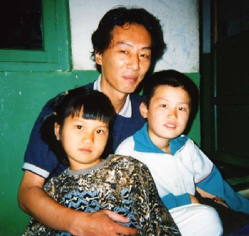 1998 -- Chol-hun and his younger sister with Mr. Lee Young Hwa (RENK's epresentative)