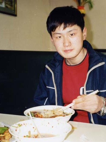 Mid-March 2004 -- At a Chinese restaurant on the way to Mongolia. He ate two big bowlfuls of Chinese noodles. Just after this photo was taken, his father recalls telling him that they would finally be reaching South Korea soon, and Chol-hun gave his biggest smile.