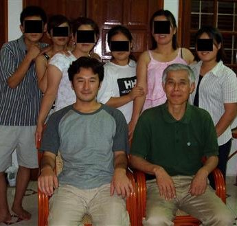 Takayuki Noguchi and executive director Kato with six North Korean refugees successfully escorted out of China to Vietnam in 2002.