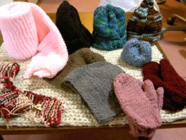"Hand-knitted scarves, hats, mittens donated by ""Ms Warmheart"""