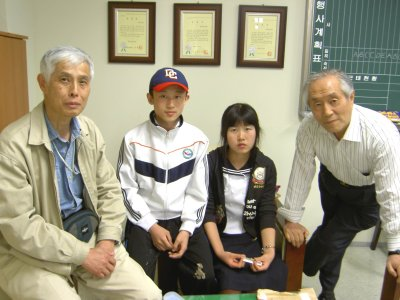 The Choi children, one year later, with Kato Hiroshi and Kim Sang-hun, a South Korean humanitarian aid worker.