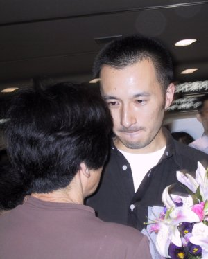 Noguchi is overcome with emotion as he  meets his family at the airport.