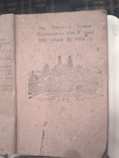 "English Textbook: Dedication Page It reads: ""The Respected Leader Generalissimo  Kim Il Sung Will Always Be With Us"""