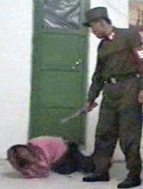 Guard beats female prisoner
