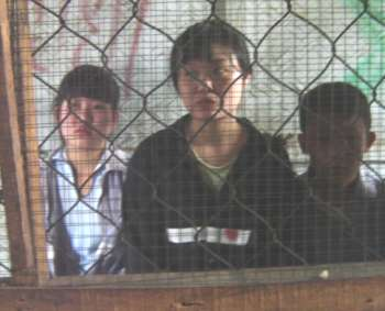 3 orphans held in Laos jail